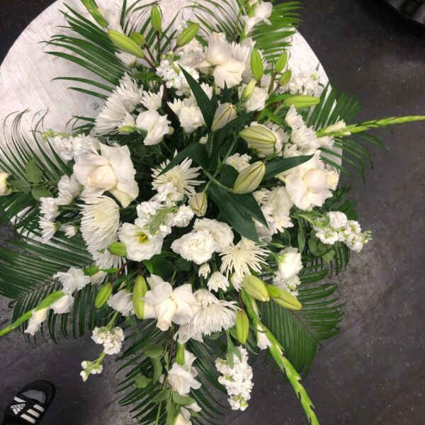 arrangement with white flowers and palms