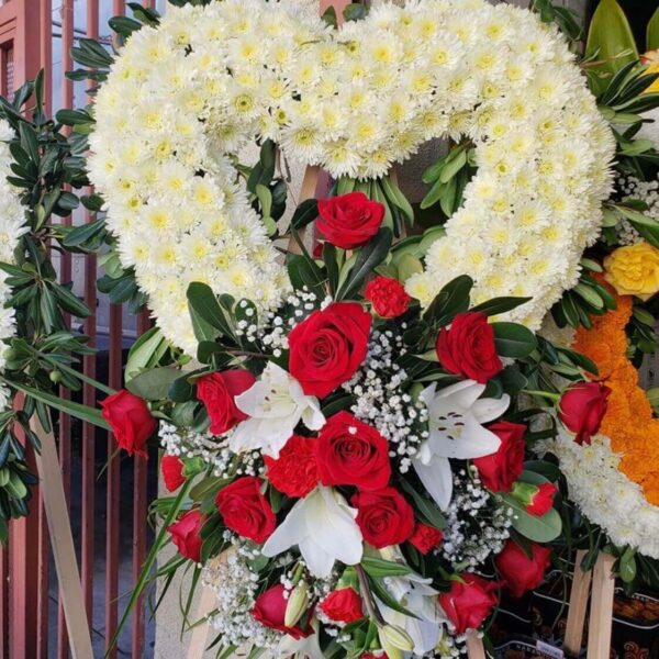 heart wreath with white flowers and red roses