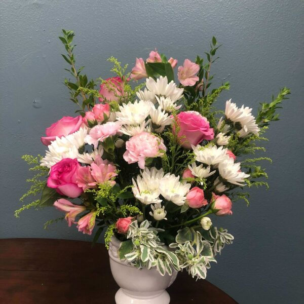 vase with pink roses and white flowers