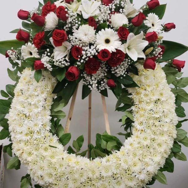 wreath of white flowers and red roses